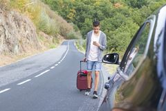 People traveling with suitcases. And car Stock Photos