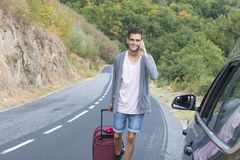 People traveling with suitcases. And car Stock Photography