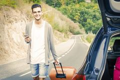 People traveling with suitcases. And car Stock Image