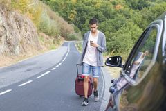 People traveling with suitcases. And car Royalty Free Stock Image