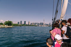 people traveling on a tall ship in lake Ontario toward downtown Toronto skyline Royalty Free Stock Image