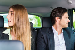 People traveling in taxi, they have an appointment Royalty Free Stock Photos