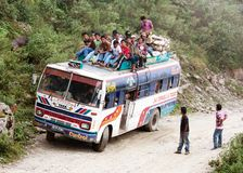 People traveling on top of autobus brand TATA Royalty Free Stock Image