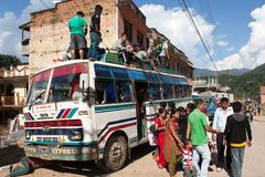 People traveling on top of autobus brand TATA Stock Images
