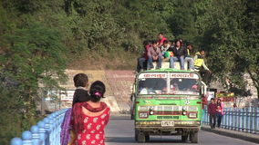 People traveling on top of bus. In Nepalese Himalayan mountain road stock video footage