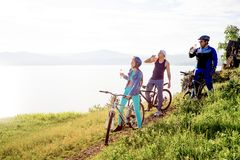 People travelling on a bicycle Royalty Free Stock Photos