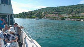 People travelling on a boat. Lake Maggiore, Stresa town stock footage