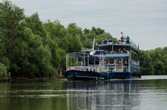 People travelling on the Danube with a boat Stock Photography