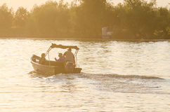 People travelling on the Danube with a boat Royalty Free Stock Image