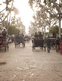 People travelling in a horse drawn carriages at the Seville Fair Stock Photos