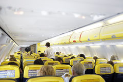 People travelling by plane. People travelling in the cabin of a plane Royalty Free Stock Photos