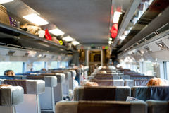 People travelling on a train. Passenger's view of the interior of a train Royalty Free Stock Photography
