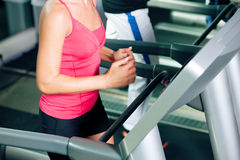 People on treadmill in gym running Stock Image