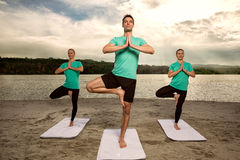 People in tree pose Royalty Free Stock Photography