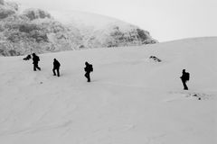 People treking. People silhouettes trekking, snow covered mountains Royalty Free Stock Photography