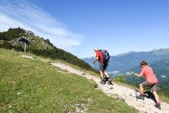 People treking on Denti della vecchia mountain over Lugano, Swit Royalty Free Stock Photography