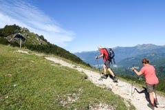 People treking on Denti della vecchia mountain over Lugano, Swit Stock Photos