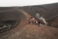 People trekking on Etna volcano, Sicily. royalty free stock photos