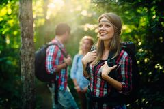 People trekking in forest and having fun royalty free stock images