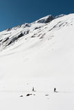 People are trekking on the snow mountain Stock Images