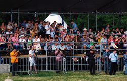 People on tribunes applause to reenactors. Royalty Free Stock Photos