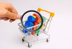 People in a trolley for a supermarket. Concept of human trafficking, modern slavery. Buying people is a violation of international royalty free stock photo