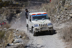 People try to reach their destination, driving through the mountain road on Annapurna trekking path. Himalayas, Nepal Royalty Free Stock Image