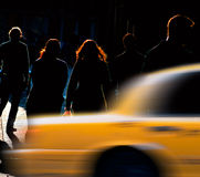 People trying to catch cab. Silhouettes of people on back lit street in New York, trying to catch a cab Royalty Free Stock Photo