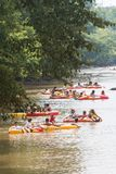 People Tube Down The Chattahoochee River On Hot Summer Day. Duluth, GA / USA - July 14, 2018:  Several people float down the Chattahoochee River on rafts and royalty free stock photography