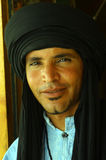 People of Tunisia. Portrait of a young Tunisian man with the typical black headgear of North Africa stock photos