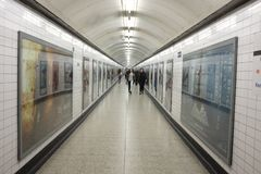People in tunnel of London underground station England Stock Photo