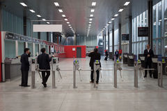 People and turnstiles at EICMA 2013 in Milan, Italy Stock Photos