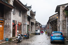 People on typical street in Xing Ping town. XINGPING, CHINA - MARCH 30, 2017: people on typical street in Xing Ping town in Yangshuo county in spring. The town Stock Images