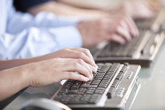 People Typing on Keyboards Royalty Free Stock Image