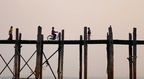 People on the Ubein bridge at sunset in Myanmar Stock Photography