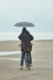 People with umbrella Stock Image