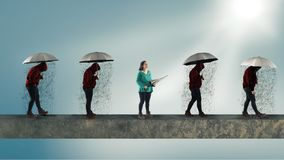 People with umbrella walking in a row in a sunny day Royalty Free Stock Photography