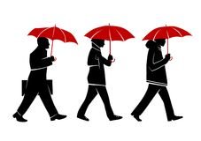 People with umbrellas. People walking with umbrellas in the street Royalty Free Stock Photo