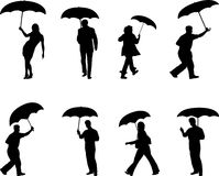 People with umbrellas. Silhouettes of people holding umbrellas Royalty Free Stock Images