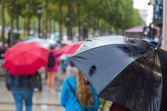 People with umbrellas in the city Stock Image