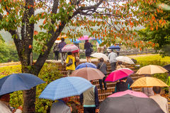 People with umbrellas. A group of tourists with colorful umbrellas. Japan Stock Images