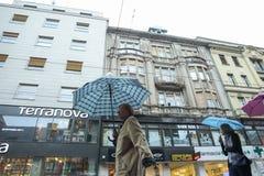 People with umbrellas on rainy day Stock Photos