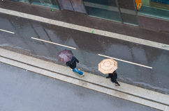 People with umbrellas Stock Images