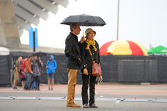 People with umbrellas, under the rain at Heineken Primavera Sound 2014 Festival. BARCELONA - MAY 28: People with umbrellas, under the rain at Heineken Primavera Stock Images