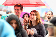 People with umbrellas watching a concert under the rain at Heineken Primavera Sound 2014 Festival Stock Images
