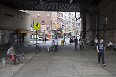 People under beginning of manhattan bridge in chinatown manhatta Royalty Free Stock Photo