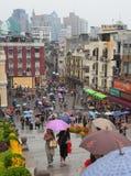 People under colourful umbrellas. Macau. China. Royalty Free Stock Image