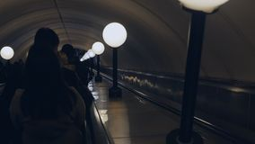 People on underground escalator. People on escalator in Moscow underground in Russia stock video footage