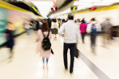People in an underground station with zoom effect Stock Photos
