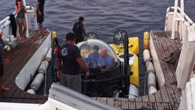 People on underwater submarine returning to ship Pacific Ocean. Cocos Island, Costa Rica - 21 September 2015: People on underwater submarine returning to ship stock footage